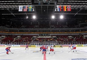 MALMO, SWEDEN - DECEMBER 26: Norway and Russia face-off during preliminary round action at the 2014 IIHF World Junior Championship. (Photo by Andre Ringuette/HHOF-IIHF Images)