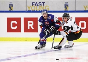 MALMO, SWEDEN - DECEMBER 27: Slovakia's #12 David Griger and Germany's #21 Dominik Kahun pursue the loose puck during preliminary round action at the 2014 IIHF World Junior Championship. (Photo by Francois Laplante/HHOF-IIHF Images)