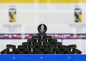 MALMO, SWEDEN - DECEMBER 28: Stacked warm-up pucks wait for the teams prior to preliminary round game USA vs. Slovakia at the 2014 IIHF World Junior Championship. (Photo by Francois Laplante/HHOF-IIHF Images)