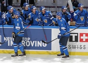 MALMO, SWEDEN - DECEMBER 28: Finland's Ville Pokka #12 and Esa Lindell #7 celebrating at the bench after taking a 1-0 lead over Sweden in preliminary round action at the 2014 IIHF World Junior Championship. (Photo by Andre Ringuette/HHOF-IIHF Images)