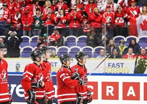 MALMO, SWEDEN - DECEMBER 28: Team Canada is lined up at the blue line prior to facing Czech Republic during preliminary round at the 2014 IIHF World Junior Championship. (Photo by Francois Laplante/HHOF-IIHF Images)
