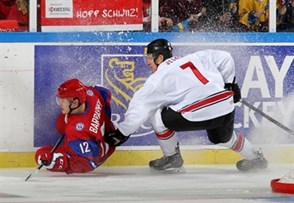 MALMO, SWEDEN - DECEMBER 28: Russia's Ivan Barbashev #12 gets tangled up with Switzerland's Benoit Jecker #7 and crashes into the board during preliminary round action at the 2014 IIHF World Junior Championship. (Photo by Andre Ringuette/HHOF-IIHF Images)