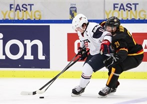 MALMO, SWEDEN - DECEMBER 29: USA's #11 Riley Barber and Germany's #21 Dominik Kahun battle for the puck during preliminary round action at the 2014 IIHF World Junior Championship. (Photo by Francois Laplante/HHOF-IIHF Images)