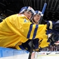MALMO, SWEDEN - DECEMBER 31: Sweden's Oskar Sundqvist #29 celebrates at the bench after Sweden took a 1-0 lead over Russia in preliminary round action at the 2014 IIHF World Junior Championship. (Photo by Andre Ringuette/HHOF-IIHF Images)