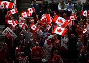 MALMO, SWEDEN - JANUARY 4: A lot of Canadian flags were waved in the stands by the fans prior to semifinal round action between Canada and Finland at the 2014 IIHF World Junior Championship. (Photo by Francois Laplante/HHOF-IIHF Images)